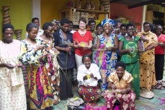 Connie Stevinson with a group of Gahaya Links weavers.